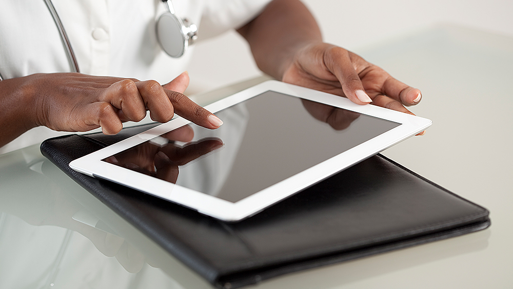 Wellspect Navina Healthcare professional using a tablet