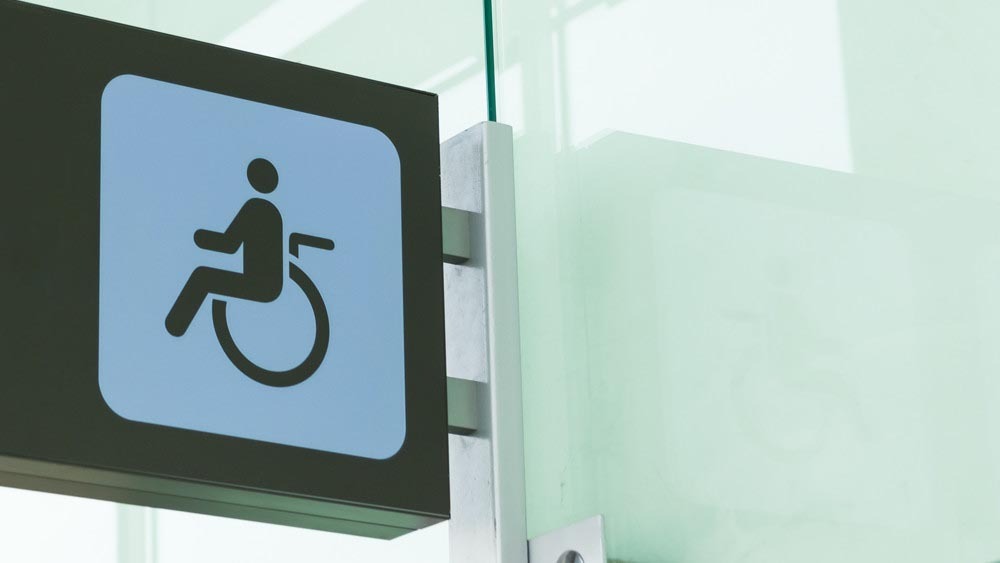 Wellspect Navina Public disabled toilet sign at airport